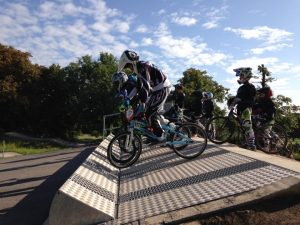 BMX riders on the gate